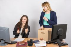 Office worker rejoices that dismissed colleague collects things Stock Photos