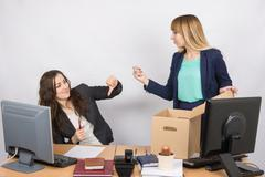 Office employee humiliating gesture of laid-off colleagues who fights back Stock Photos