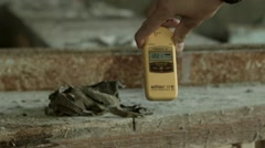 The dosimeter measures radiation in the  abandoned clinic in Pripyat. Stock Footage