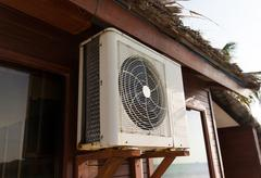 Close up of air conditioner at bungalow house Stock Photos