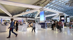 People shop at duty free boutiques at the International Airport Suvarnabhumi Stock Footage