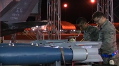 FORT WALTON USA, MARCH 2016, Close Up Two US Soldiers Check Rockets Trailer - stock footage