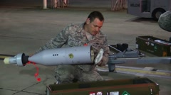 FORT WALTON USA, MARCH 2016, Close Up US Two Soldiers Check Rocket Detonator - stock footage
