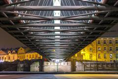 Bernatka footbridge over Vistula river in the night in Krakow, Poland Stock Photos
