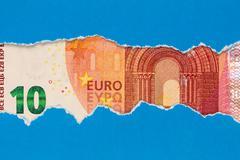 Ten Euro in torn paper frame - stock photo