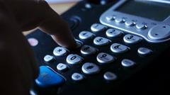 Man dialing telephone, CU - stock footage
