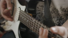 Professional Guitarist Playing Riffs On Electric Guitar At Home Studio. Close Up - stock footage