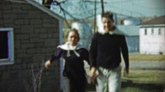 1959: Couple wearing matching navy sweater type outfits. Stock Footage