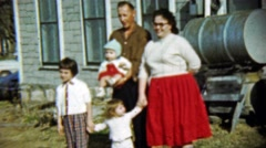 1959: Happy family poses gasoline fuel barrell front house. Stock Footage