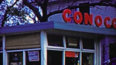 1959: Conoco gas service station sign commerical business storefront. - stock footage