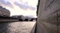 Walking along Seine River Stock Footage