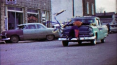 1959: Mannequin strapped to decorated parade car hood. Stock Footage