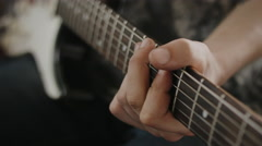 Professional Guitarist Playing Riffs On Electric Guitar At Home Studio. Close Up Arkistovideo