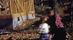 1959: Cute kids play rough autumn home construction site. - stock footage