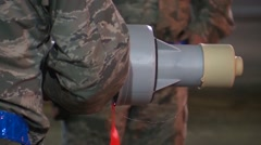 FORT WALTON USA, MARCH 2016, Detail US Soldiers Fix Detonater On Rocket - stock footage