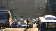 Time lapse of city traffic on uphill road in downtown Seoul at sunset Stock Footage