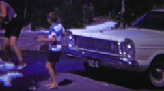 1966: Kids happy play summer mountain unmelted snow patch. - stock footage
