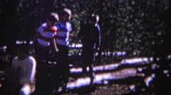 1966: Family bouncing tree limb trampoline forest park vacation. Stock Footage