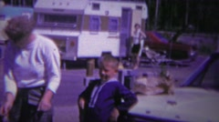 1966: Fishermen catch stringer trout fish RV park campground. - stock footage