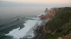 Sea rocks, sea shore, Cabo de Roca, Cape Roca, sunset, Portugal Stock Footage