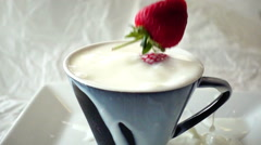 Strawberry dropping into fresh milk bowl breakfast, HD slow motion Stock Footage
