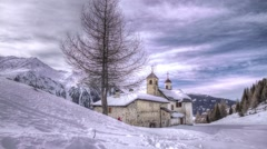 Chapel in the Alps at winter season -Motion lapse Stock Footage