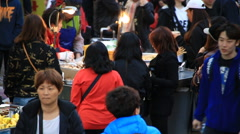 People eating Korean traditional street food, stir-fried Rice Cake (Topokki) Stock Footage