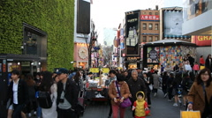 Crowd of people walking and shopping at Myeongdong street in Seoul Stock Footage