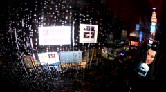 NEW YORK CITY – JUNE 2013: Times Suare ads through a window at night during Stock Footage