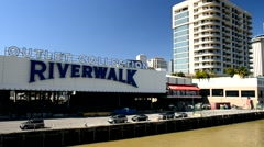 NEW ORLEANS – FEBRUARY 2016: Riverwalk skyline with tourists on a sunny day. Stock Footage