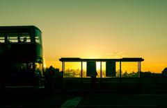 Bus stop at sunset Kuvituskuvat