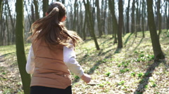 Girl running on the spring forest. 4k Stock Footage