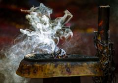 Incense burning in a Hinduist temple Stock Photos