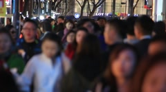 Crowd of people walking and shopping on Myeongdong street in Seoul Stock Footage