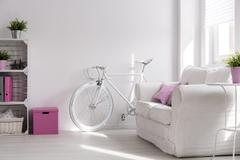 Girly interior with white, stylish bike - stock photo