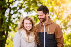 Couple in love  in autumn nature on a walk - stock photo