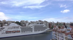 Passengers watch cruise ship, Salvador harbor, Brazil Stock Footage