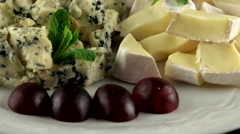 Different sort of cheese with fresh grapes, loop Stock Footage