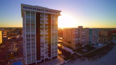 Pan right to left of sun and high rise condominium near Tampa Bay, Florida - stock footage