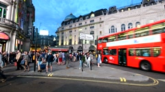 LONDON – MAY 22, 2015: Tourists in Piccadilly Circus at night. London attracts Stock Footage
