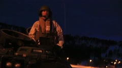 NAMSOS NORWA, MARCH 2016, US Soldier On Top Amphibious Tank Looks Around Stock Footage