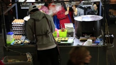 Young man selling Korean traditional street food, egg bread on Myeongdong street Stock Footage