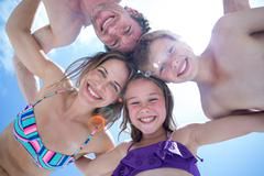 Directly below shot of happy family huddling - stock photo