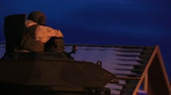 NAMSOS NORWA, MARCH 2016, Close Up US Soldier On Top Amphibious Tank Looks Stock Footage