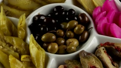 Plate of pickles (eggplant, cucumbers, turnips, olives), loop Stock Footage