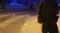 NAMSOS NORWA, MARCH 2016, Close Up US soldiers Walk Along Snowy Street Stock Footage