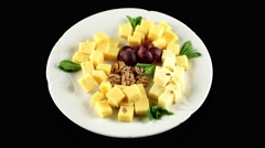 Cheese platter with different sort of organic fresh cheese, loop, top view - stock footage