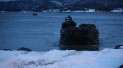 NAMSOS NORWA, MARCH 2016, US Amphibious Vehicle Drive On Snowy Beach Stock Footage
