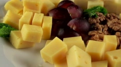 Various types of cheese in the white plate, loop Stock Footage