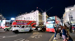 LONDON – MAY 22, 2015: Traffic in Piccadilly Circus at night. London attracts 30 Stock Footage